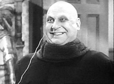 Jackie Coogan as Fester in The Addams Family