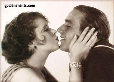 Clara Bow kissing co-star James Hall in The Fleet's In (1929)